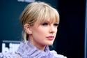 تسريحات المغنية الجميلة تيلور سويفت Taylor Swift! صورة 1