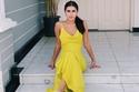تسريحات شعر ديمة الشيخلي بفستان أصفر بسيط